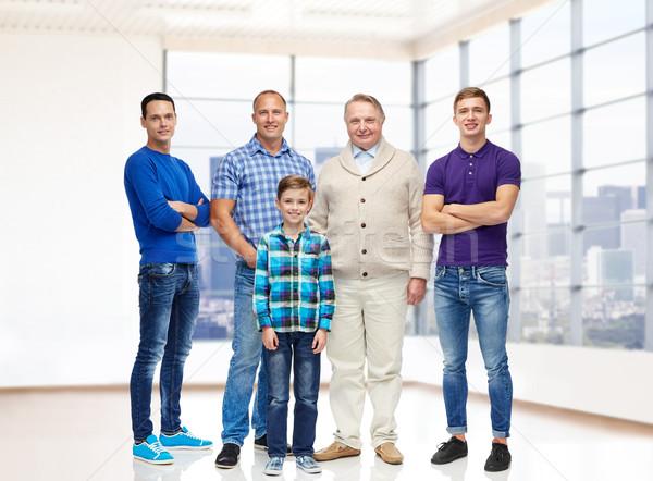 Csoport mosolyog férfiak fiú ingatlan nem Stock fotó © dolgachov