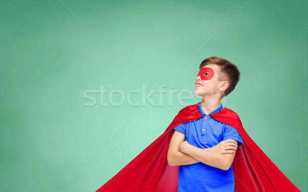 Fiú piros szuperhős maszk iskola oktatás Stock fotó © dolgachov