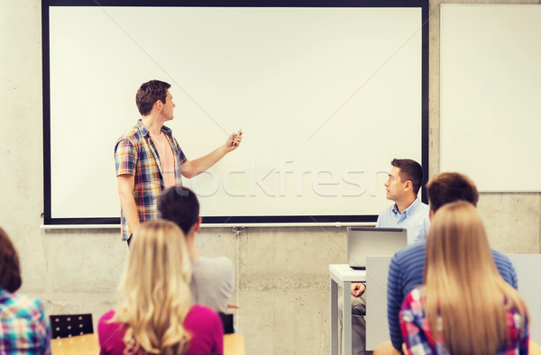 group of students and teacher in classroom Stock photo © dolgachov