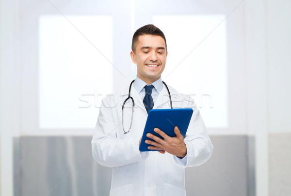 улыбаясь мужской доктор белый пальто здравоохранения Сток-фото © dolgachov