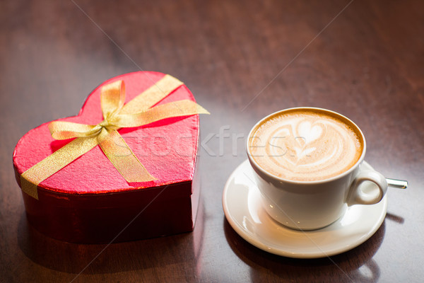 close up of gift box and coffee cup on table Stock photo © dolgachov