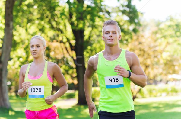 Mutlu çift yarış rozet sayılar uygunluk Stok fotoğraf © dolgachov