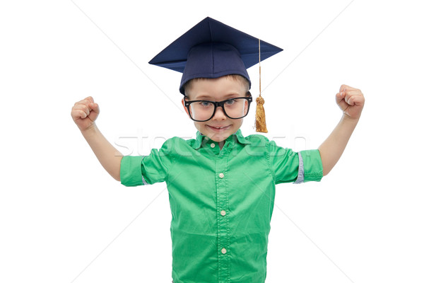 happy boy in bachelor hat showing power Stock photo © dolgachov