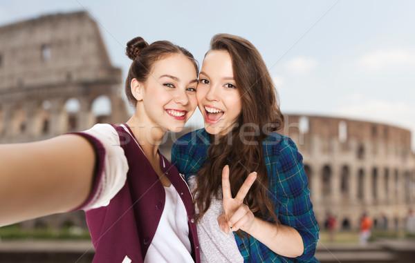friends taking selfie over coliseum Stock photo © dolgachov