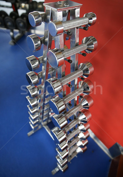 close up of dumbbells and sports equipment in gym Stock photo © dolgachov