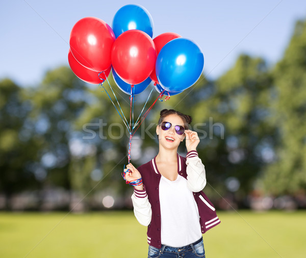 happy teenage girl with helium balloons Stock photo © dolgachov