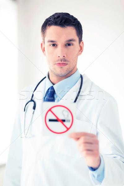 male doctor holding no smoking sign Stock photo © dolgachov