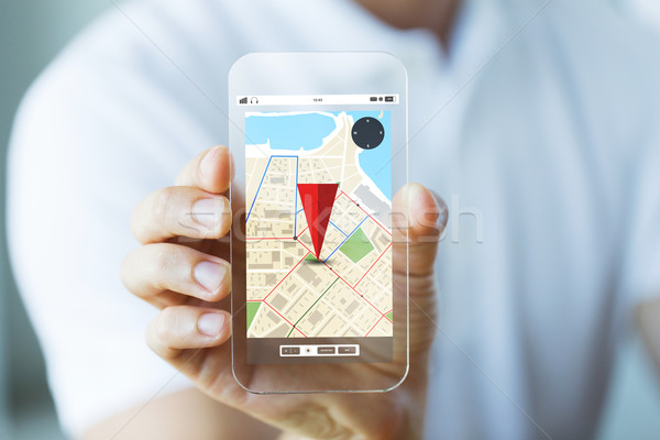 close up of male hand showing map on smartphone Stock photo © dolgachov
