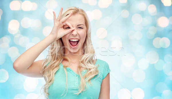 young woman making ok hand gesture Stock photo © dolgachov