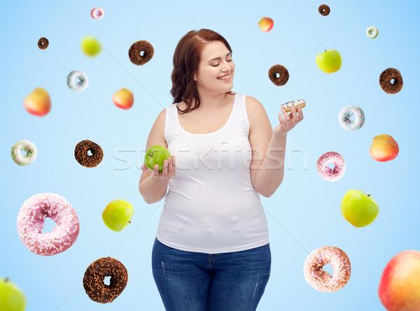 happy plus size woman choosing apple or donut Stock photo © dolgachov