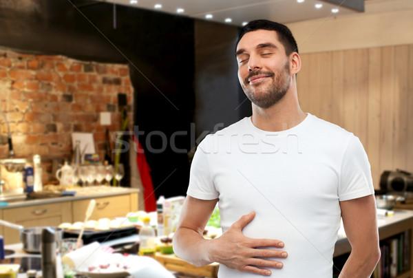 Boldog tele férfi megérint pocak konyha Stock fotó © dolgachov