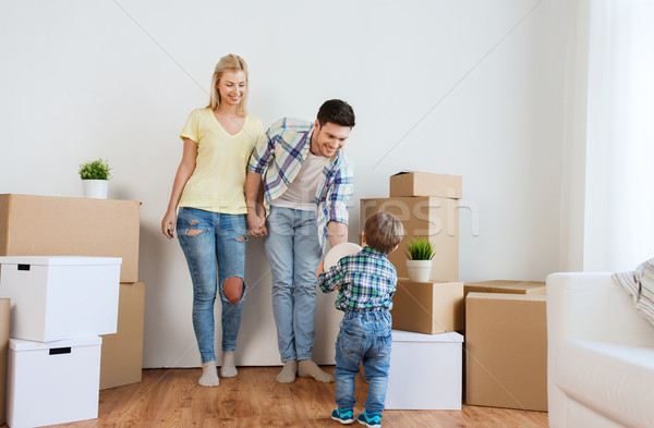 happy family moving to new home and playing ball Stock photo © dolgachov