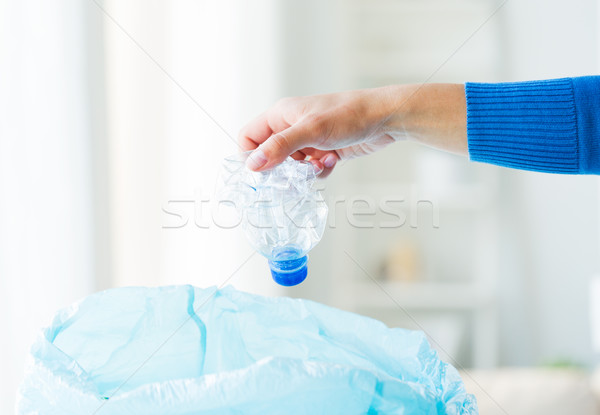 close up of hand and used bottles in rubbish bag Stock photo © dolgachov