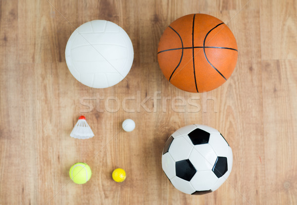 close up of different sports balls and shuttlecock Stock photo © dolgachov