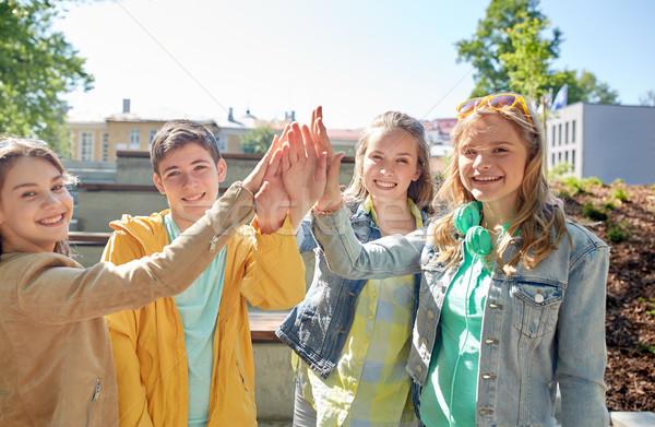 Gelukkig studenten vrienden high five onderwijs Stockfoto © dolgachov