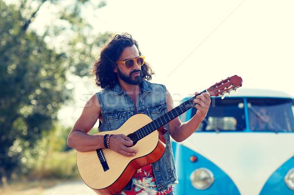 hippie man playing guitar over minivan car outdoor Stock photo © dolgachov