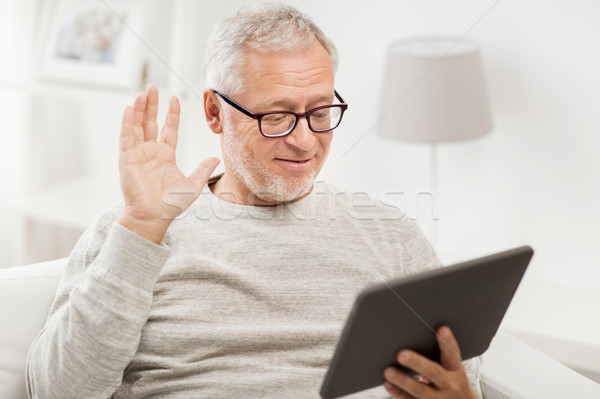 senior man having video call on tablet pc at home Stock photo © dolgachov