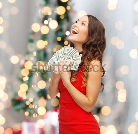 beautiful sexy woman in red dress with gift box Stock photo © dolgachov