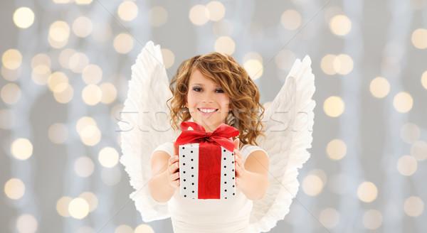 Heureux femme ailes d'ange Noël cadeau personnes Photo stock © dolgachov