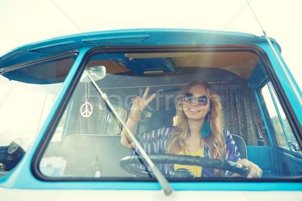 smiling young hippie woman driving minivan car Stock photo © dolgachov