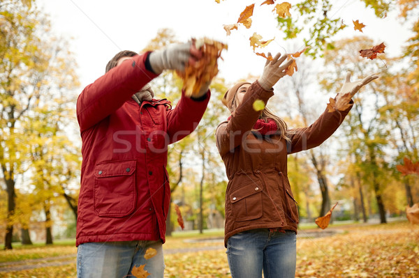 happy young couple throwing autumn leaves in park Stock photo © dolgachov