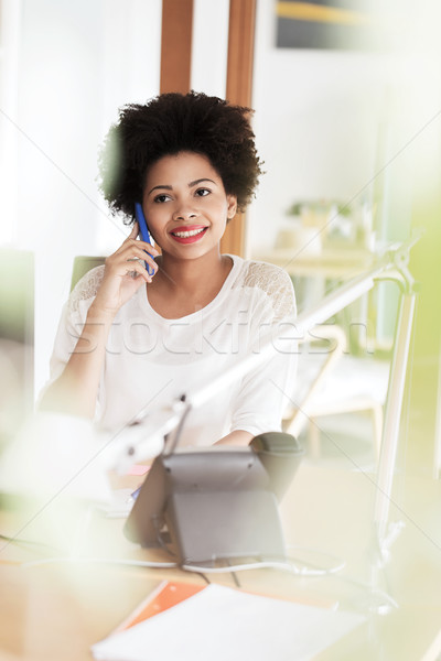 Stock photo: businesswoman calling on smartphone at office