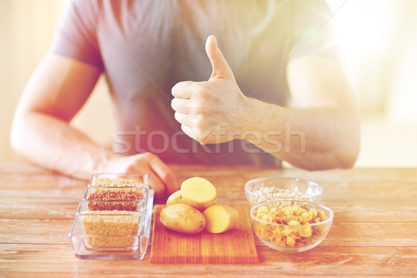 close up of male hands with carbohydrate food Stock photo © dolgachov