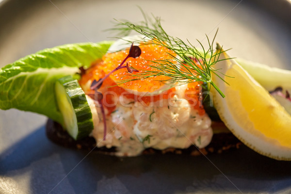 close up of toast skagen with caviar and bread Stock photo © dolgachov