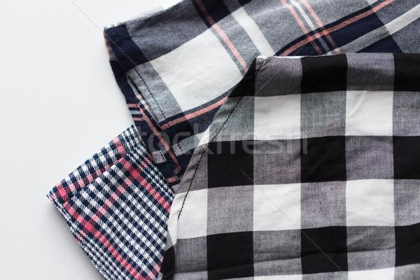 close up of checkered shirt on white background Stock photo © dolgachov
