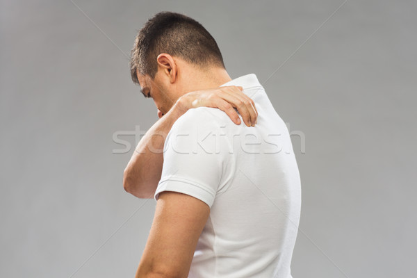 close up of man suffering from backache Stock photo © dolgachov