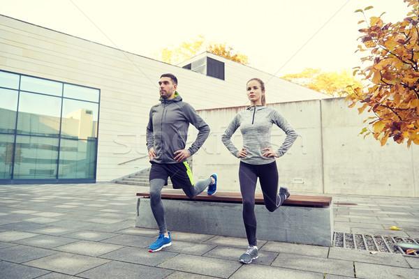 couple doing lunge exercise on city street Stock photo © dolgachov