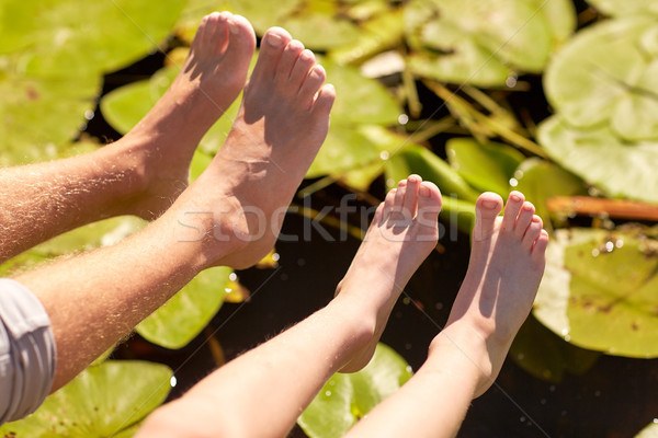 grandfather and grandson feet over river Stock photo © dolgachov