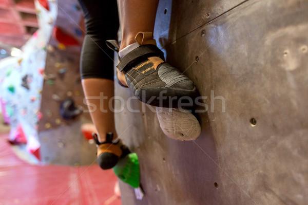 feet of woman exercising at indoor climbing gym Stock photo © dolgachov