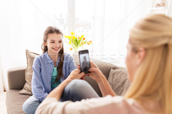 happy family taking photo by smartphone at home Stock photo © dolgachov