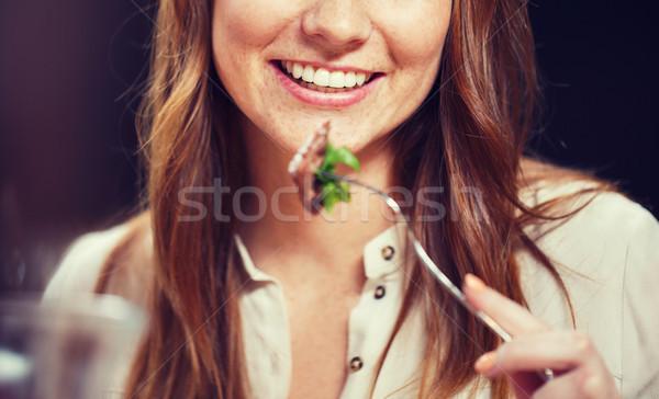 happy young woman having dinner at restaurant Stock photo © dolgachov