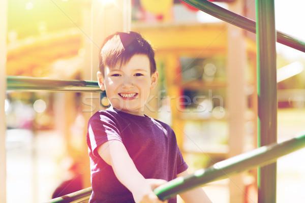 Boldog kicsi fiú mászik gyerekek játszótér Stock fotó © dolgachov