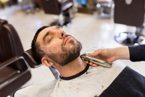 Homme barbier barbe salon Photo stock © dolgachov