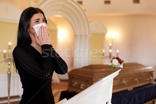 woman with coffin crying at funeral in church Stock photo © dolgachov