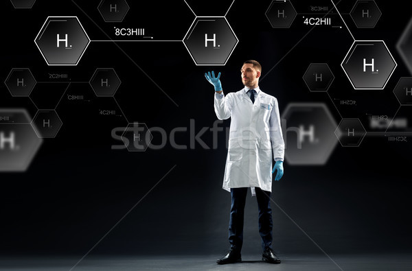 scientist with virtual chemical formula projection Stock photo © dolgachov