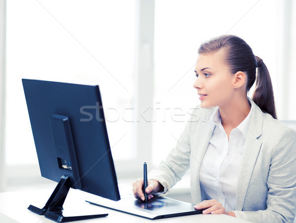 businesswoman with drawing tablet in office Stock photo © dolgachov