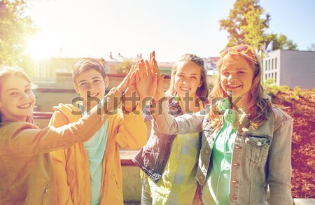 happy hippie friends at minivan car on island Stock photo © dolgachov
