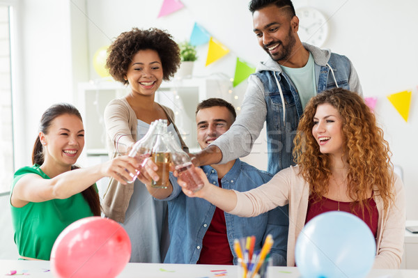 happy team with drinks celebrating at office party Stock photo © dolgachov