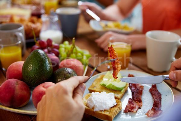 Kezek szalonna villa asztal tele étel Stock fotó © dolgachov