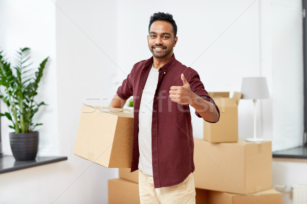 man with box moving to new home showing thumbs up Stock photo © dolgachov