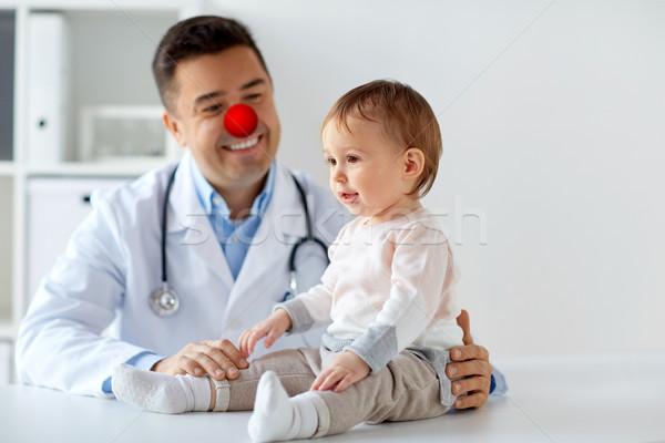 счастливым врач красный носа день Сток-фото © dolgachov