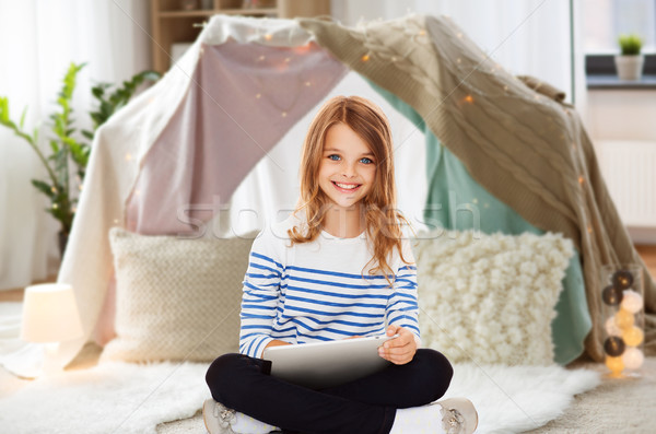 student girl with tablet pc at home Stock photo © dolgachov