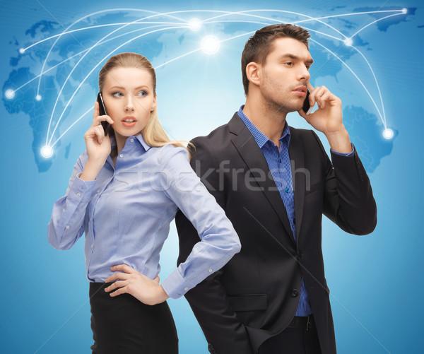 Stockfoto: Man · vrouw · mobiele · telefoons · foto · business · wereld