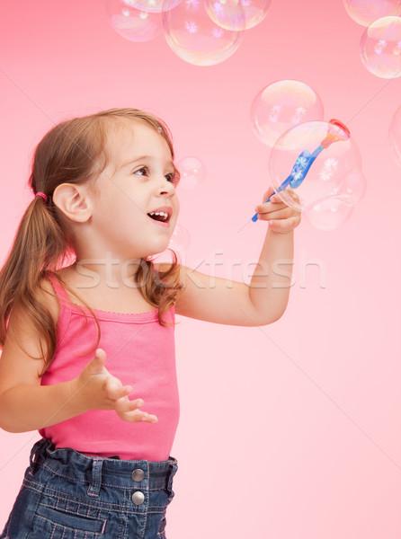 Fille bulles de savon lumineuses photos belle enfants Photo stock © dolgachov