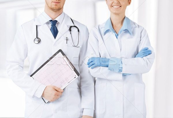 nurse and male doctor holding cardiogram Stock photo © dolgachov