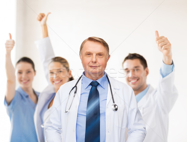 smiling doctor or professor with stethoscope Stock photo © dolgachov